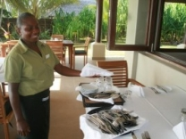 Yvonne setting tables with a smile in eratap luxury resort vanuatu